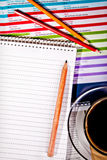 Coffee and notebook on desknotebook. Coffee cup and notebook with pencil on desk stock image