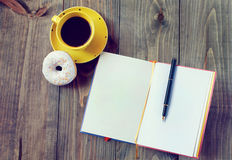 Coffee and notebook. Coffee and donut notebook a morning stock image