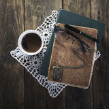 Coffee, notebook,glasses and old necklace Stock Images