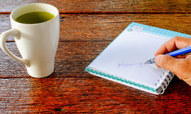 Coffee , Notebook , Morning writing pen in hand,All place on Dar Stock Photos