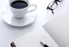 Coffee and notebook Stock Image