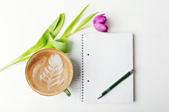 Coffee and notebook. Notebook with pen and coffee, flat lay, copy space Royalty Free Stock Images