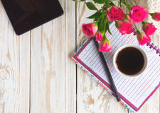 Coffee, notebook, pensil and tablet Stock Image