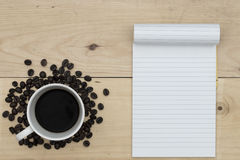 Coffee and notebook on wood table Royalty Free Stock Photos
