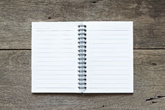 Notebook on wooden background Royalty Free Stock Images