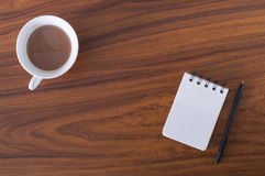 Coffee and notebook Stock Images