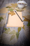 Coffee and notebook on wooden table Stock Image