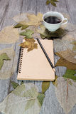 Coffee and notebook on wooden table Royalty Free Stock Photo