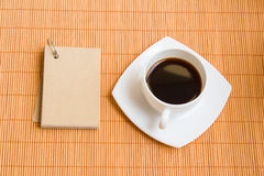 Coffee and NotePad. Bamboo blind BG and my Obj.'s notepad & Thai style cake Royalty Free Stock Image