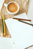 Coffee, notepad and color pencils Stock Photos