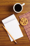 Coffee and notepad with cookies Royalty Free Stock Photo