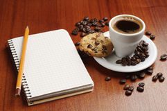 Coffee and notepad Stock Image