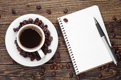 Coffee and notepad royalty free stock photos