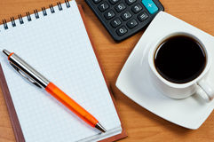 Coffee, notepad and pen on table. Royalty Free Stock Photos
