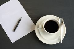Coffee and notepaper Stock Images