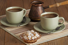Coffee and nougat. Two cups of coffee and nougat on a old table Royalty Free Stock Photo