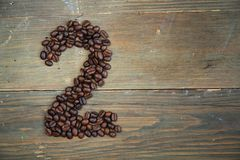 Coffee number two. Number two made with coffee beans on a wooden plank Stock Photos