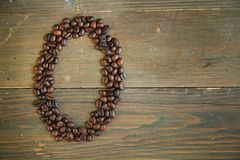 Coffee number zero. Number zero made with coffee beans on a wooden plank Royalty Free Stock Image