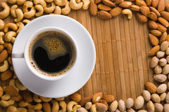 Coffee with nuts on background Stock Image