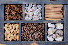 Coffee, nuts and spices in rusted wooden box Royalty Free Stock Photos