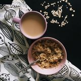 Coffee and oatmeal on black table Royalty Free Stock Image