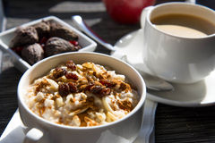Coffee and oatmeal with dried fruit  healthy breakfast setting Royalty Free Stock Image