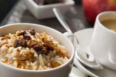 Coffee and oatmeal with dried fruit  healthy breakfast setting Royalty Free Stock Images
