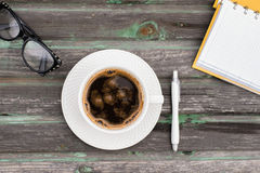 Coffee. Office desk table with supplies and coffee cup. Top view with copy space Stock Images