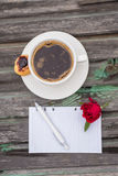 Coffee. Office desk table with supplies and coffee cup. Top view with copy space Royalty Free Stock Photography