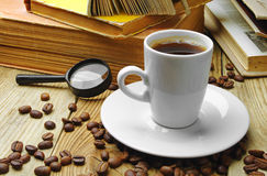 Coffee and old books. Coffee, old books and magnifying glass Stock Photos