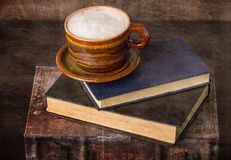 Coffee and old books Stock Images