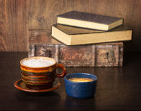 Coffee and old books stock image