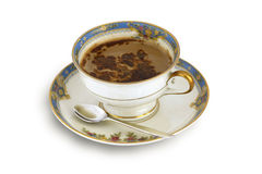 Coffee in old ceramic cup. Aromatic, black coffee with chocolate in  old, vintage, ceramic cup (on white Stock Photography