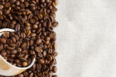 Coffee on old fabric Stock Image