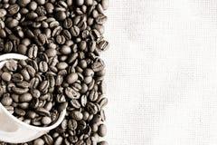 Coffee on old fabric Stock Photos