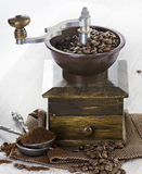 Coffee and old-fashioned coffee grinder Stock Photography