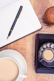 Coffee with old land line and book. Close-up of coffee with old land line and book on table Stock Photos