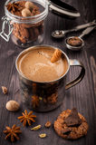 Coffee in the old mug, chocolate,   cookies and spices Royalty Free Stock Photo