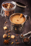Coffee in the old mug and spices Royalty Free Stock Images