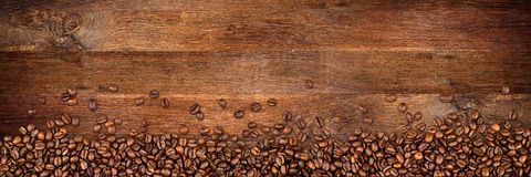 Coffee old oak background. Coffee  beans on wide rustic oak background Stock Photography