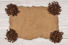 Coffee on old paper and wooden table. Royalty Free Stock Photography
