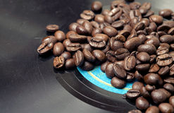 Coffee is on the old threadbare audio vinyl Royalty Free Stock Photo