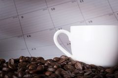 Coffee On The Table With Calendar Stock Photography