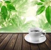 Coffee On Wood Floor With Green Bokeh . Stock Image