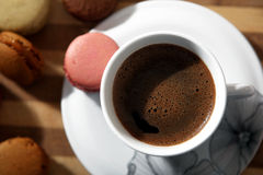 Coffee and one macaron. Coffee and small cake for breakfast Royalty Free Stock Images