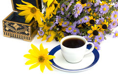 Coffee, open casket and wild flowers, still life, isolate Royalty Free Stock Images