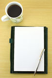 Coffee, open notebook and pen Stock Image