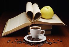 Coffee and opened book Royalty Free Stock Photography