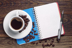 Coffee and opened notebook Royalty Free Stock Image