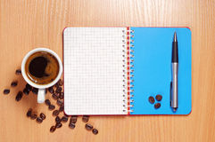 Coffee, opened notebook and pen Stock Images